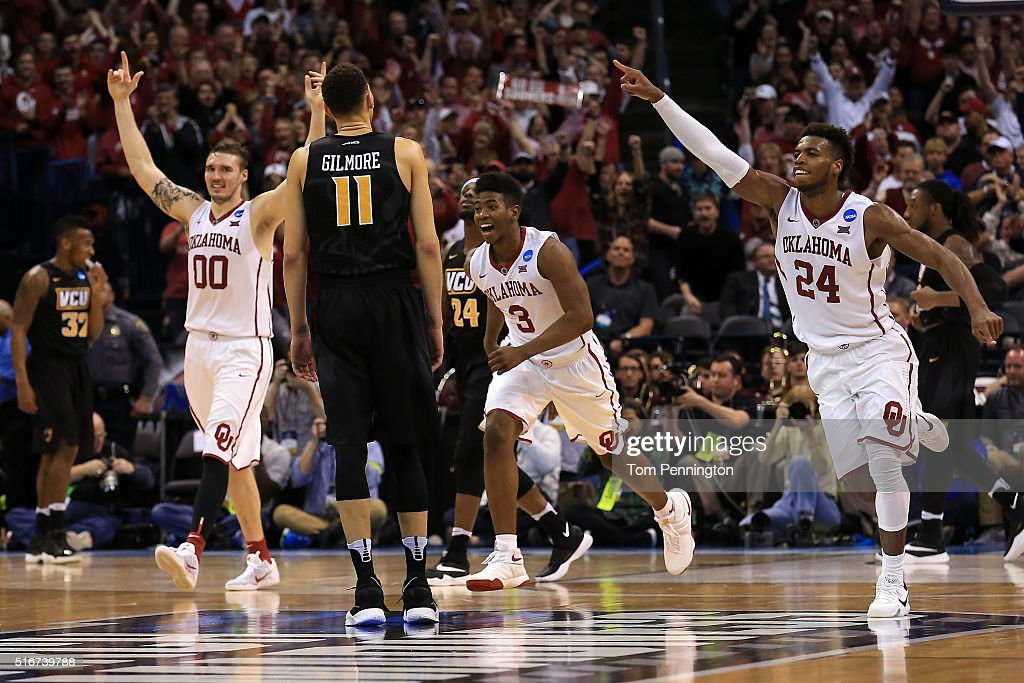 Buddy Hield #24, Ryan Spangler #00 and Christian James #3 of the Oklahoma Sooners celebrate after defeating the Virginia Commonwealth Rams with a score of 81 to 85 during the second round of the 2016 NCAA Men's Basketball Tournament at Chesapeake Energy Arena on March 20, 2016 in Oklahoma City, Oklahoma.