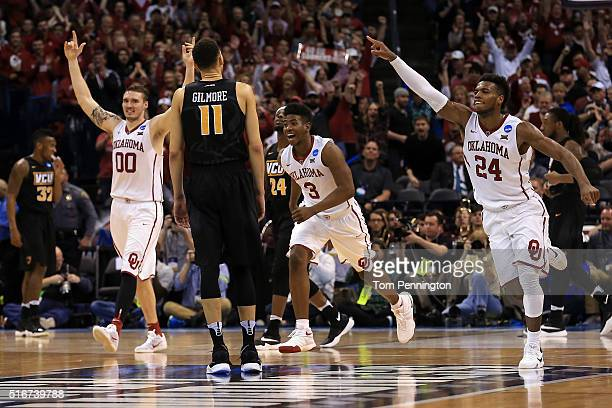 Buddy Hield, Ryan Spangler and Christian James of the Oklahoma Sooners celebrate after defeating the Virginia Commonwealth Rams with a score of 81 to...