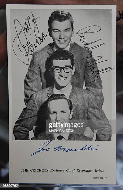 A Buddy Holly and The Crickets Band signed postcard on display before an auction of the late singers memorabilia at the Heritage Auction Gallery in...
