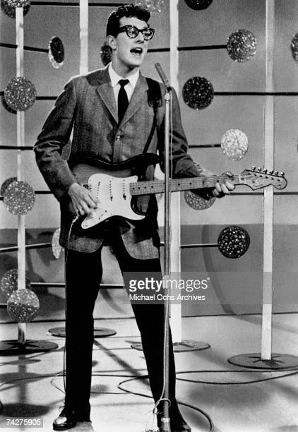 Buddy Holly of the rock and roll band Buddy Holly And The The Crickets plays a Fender Stratocaster guitar as he performs onstage on the set of the...