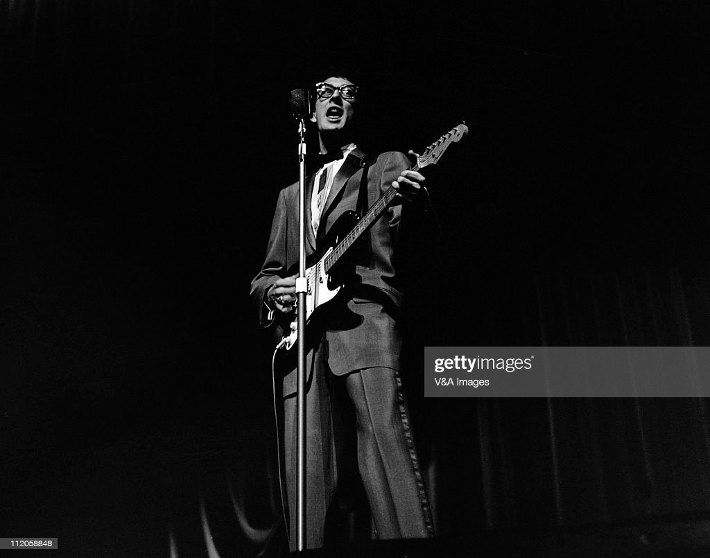 Buddy Holly, performs on stage, playing Fender Stratocaster guitar, 25 March 1958.