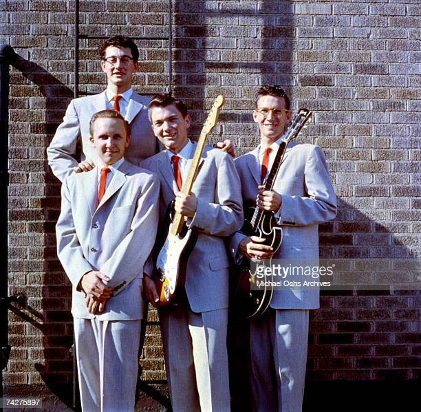 Buddy Holly poses for a portrait with his group Buddy Holly The Crickets including Jerry Allison Joe B Mauldin and Niki Sullivan holding a Gibson...