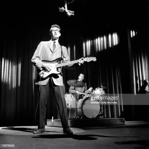 Buddy Holly & The Crickets L-R: Buddy Holly and Jerry Allison perform on the Ed Sullivan Show at the Ed Sullivan Theatre on January 26, 1958 in New...