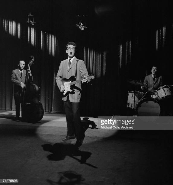 Buddy Holly & The Crickets L-R: Joe Mauldin, Buddy Holly, Jerry Allison perform on the Ed Sullivan Show at the Ed Sullivan Theatre on January 26,...