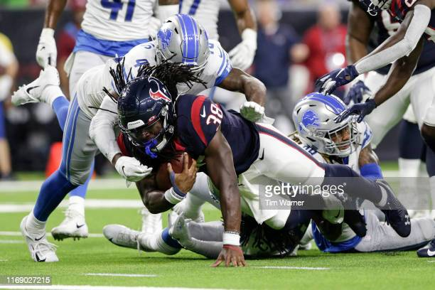 Buddy Howell of the Houston Texans is tackled by Jarrad Davis of the Detroit Lions in the second half during the preseason game at NRG Stadium on...