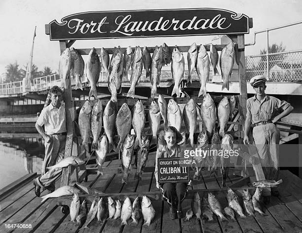 Buddy Merritt and Carol Chance pose on the dock with a day's catch from the Caliban II fishing boat in Fort Lauderdale Florida on May 29 1939