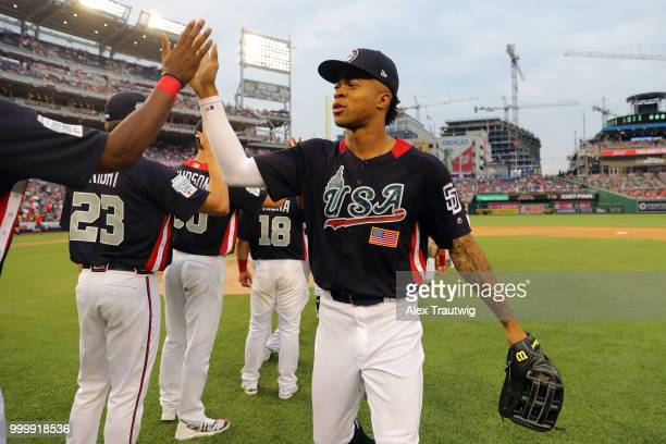 Buddy Reed of Team USA celebrates with teammates after Team USA defeated the World Team in the SiriusXM AllStar Futures Game at Nationals Park on...