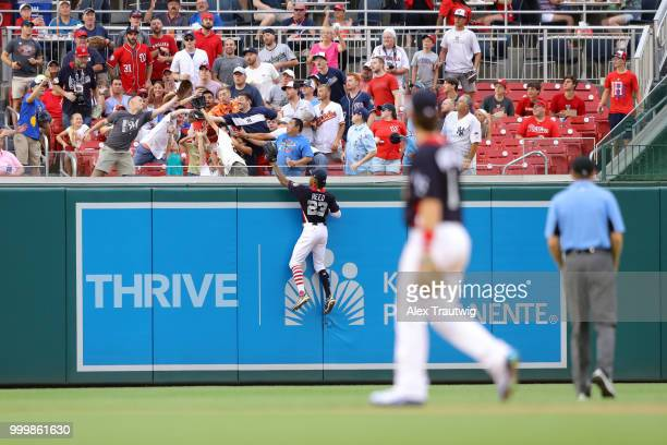 Buddy Reed of Team USA climbs the wall in an attempt to catch a Yusniel Diaz of the World Team home run reach the stands during the SiriusXM AllStar...