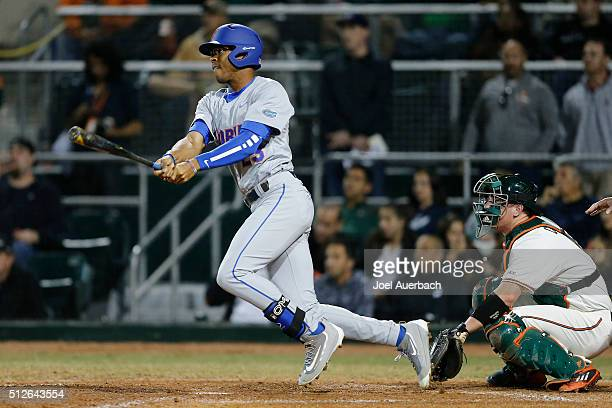 Buddy Reed of the Florida Gators hits the ball against the Miami Hurricanes on February 26 2016 at Alex Rodriguez Park at Mark Light Field in Coral...