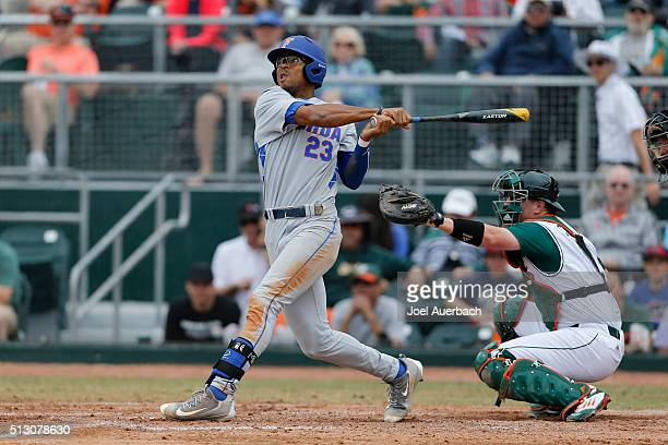 Buddy Reed of the Florida Gators hits the ball against the Miami Hurricanes on February 28 2016 at Alex Rodriguez Park at Mark Light Field in Coral...