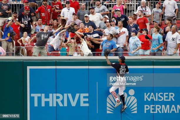 Buddy Reed of the San Diego Padres and the US Team cannot make a catch on a home run hits a by Yusniel Diaz of the Los Angeles Dodgers and the World...