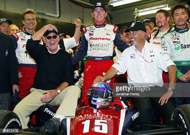 Buddy Rice driver of the Argent Letterman Rahal Racing Honda G Force celebrates with team owners David Letterman and Bobby Rahal in a makeshift...