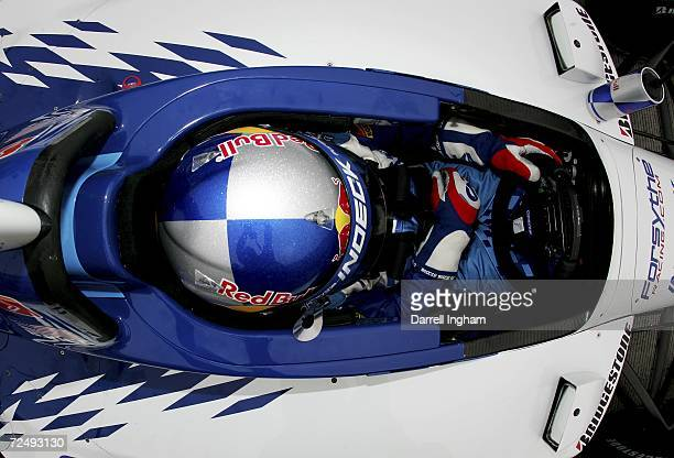 Buddy Rice driver of the Forsythe Championship Racing Lola Cosworth sits in his race car during practice for the Champ Car World Series Gran Premio...