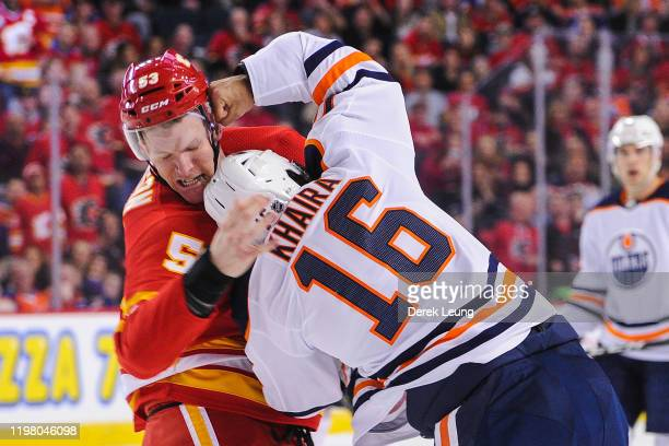 Buddy Robinson of the Calgary Flames fights Jujhar Khaira of the Edmonton Oilers during an NHL game at Scotiabank Saddledome on February 1 2020 in...