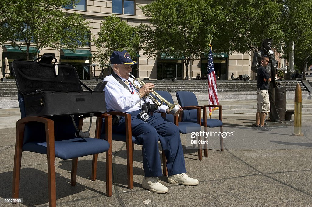 Buddy Verdi, who served in World War II aboard the USS Springfield, warms up with his trumpet for his playing of taps during the memorial service in honor of the ship at the Navy Memorial in Washington on Friday, May 22, 2009. Over eighty former crew members are in DC for a week or reunion activities. Buddy left Benny Goodman's band in 1944 to join the US Navy, and was also aboard the USS Missouri for the surrender of the Japanese.