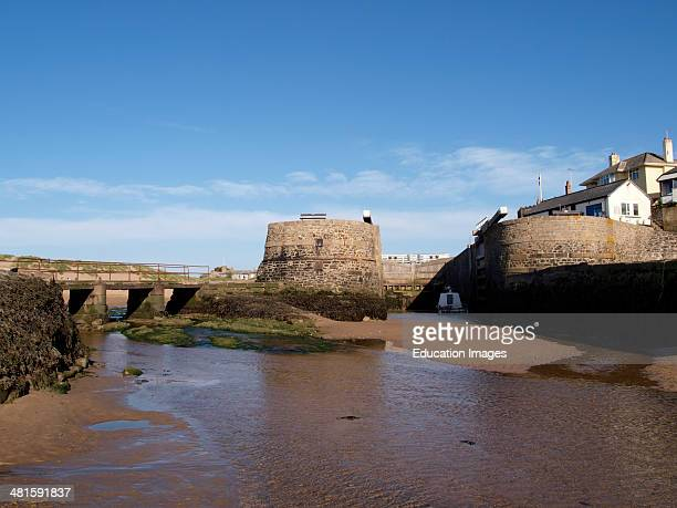 Bude canal lock gates where it meets the sea at low tide Cornwall UK