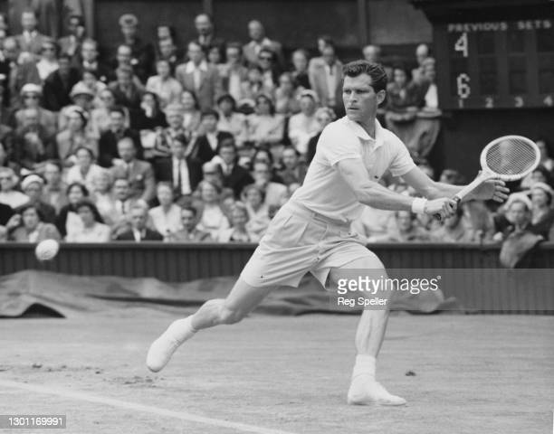 Budge Patty of the United States eyes the tennis ball to make a backhand return against Robert Wilson of Great Britain during their Men's Singles...