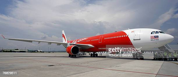 Budget air carrier AirAsia X's first leased Airbus A330 longhaul aircraft sits on the tarmac of the Kuala Lumpur International Airport's lowcost...
