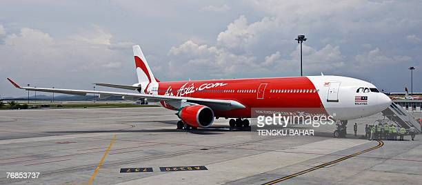 Budget air carrier AirAsia X's first leased Airbus A330 longhaul aircraft sits on tarmac of the Kuala Lumpur International Airport's lowcost carrier...