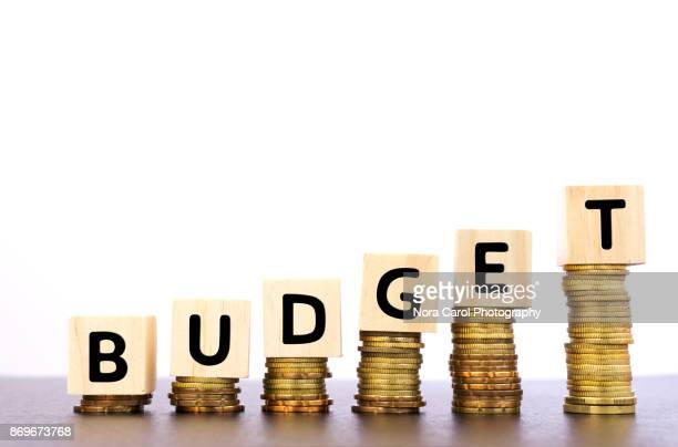 budget word on wood block on top of coins stack - economy stock pictures, royalty-free photos & images