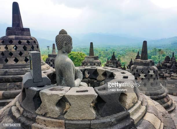 budha statue at borobudur temple - yogyakarta stock pictures, royalty-free photos & images
