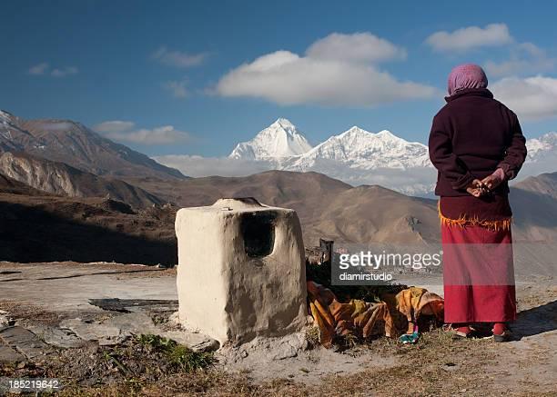 Budhist monk looking at Dhaulagiri (8167m) Muktinath, Nepal