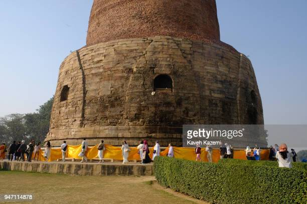 Budhist pilgrims circle around the Dhamek Stupa on January 30 2018 in Sarnath India Dhamek Stupa which is also spelled as Dhamekh and Dhamekha is one...