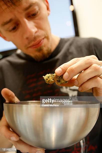 Budtender Cody Blake handles marijuana at Perennial Holistic Wellness Center a notforprofit medical marijuana dispensary in operation since 2006 on...