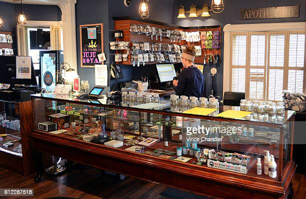 A budtender organizes and inventories marijuana flower at The Health Center a medical cannabis and recreational marijuana dispensary in Denver