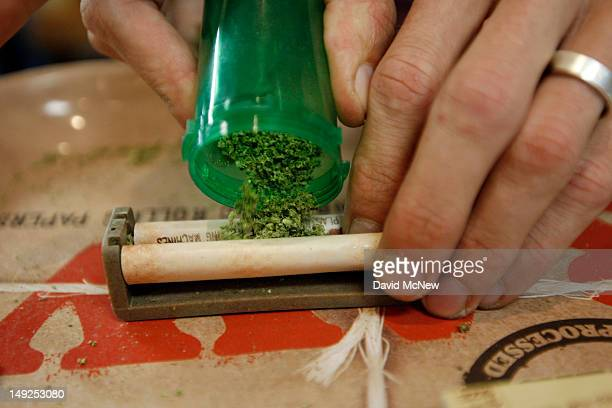A budtender rolls a marijuana cigarette for a patient at Perennial Holistic Wellness Center medical marijuana dispensary which opened in 2006 on July...