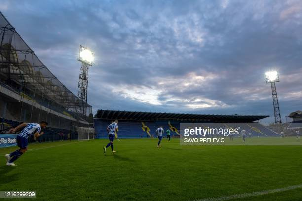 FC Buducnost players enter the field of play ahead of the football match between FC Buducnost and FC Grbalj at the Podgorica City stadium on May 30...