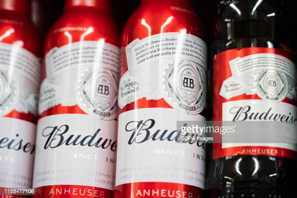 Budweiser beer bottles displayed for sale in a Carrefour supermarket in Shanghai.