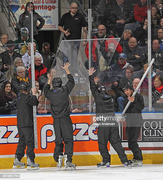 Budweiser Gardens ice crew replace a piece of glass during play stoppage between the Windsor Spitfires and the London Knights in an OHL game at...