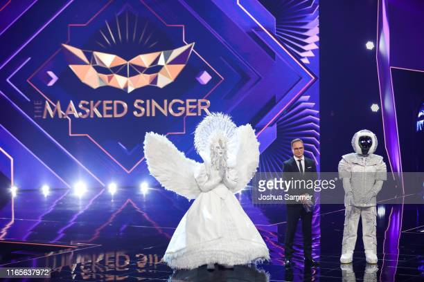 Buelent Ceylan Matthias Opdenhoevel and Max Mutzke at the The Masked Singer finals at Coloneum on August 01 2019 in Cologne Germany