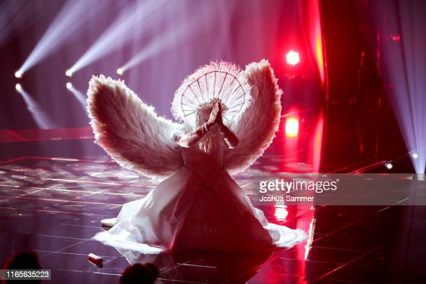 Buelent Ceylan performs during the The Masked Singer finals at Coloneum on August 01 2019 in Cologne Germany