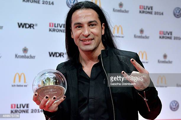 Buelent Ceylan poses with the award during the 1Live Krone 2014 at Jahrhunderthalle on December 4 2014 in Bochum Germany
