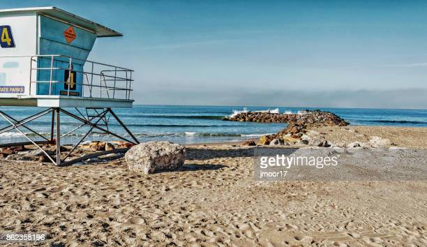 Buena Ventura City Park Lifeguard Station and Log on Rocks