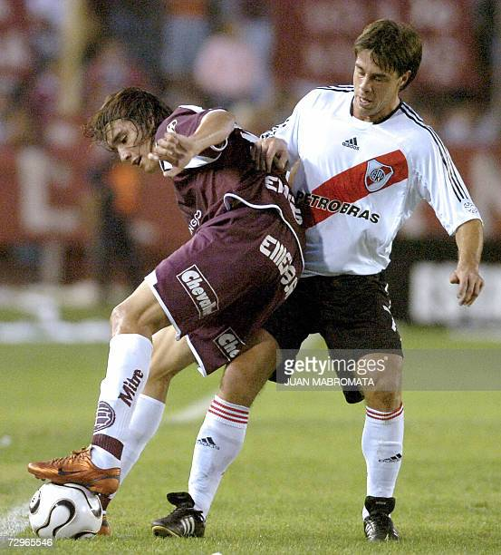 A file photo taken 02 April 2006 shows Lanus' Sebastian Leto vying for the ball with River Plate's Lucas Pusineri during their Clausura tournament...