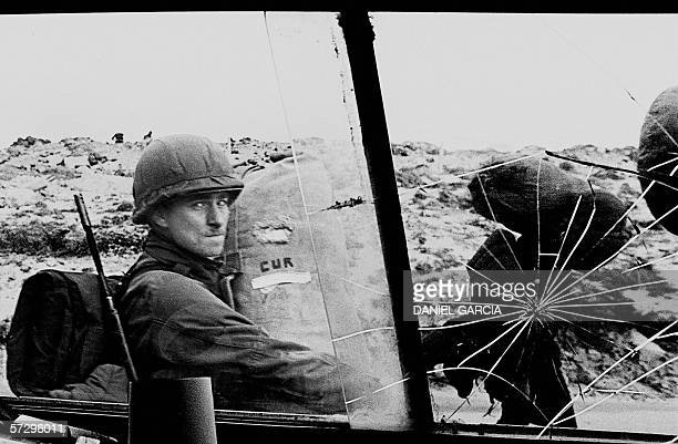 An Argentine soldier seen 13 April 1982 in his way to occupy the captured Royal Marines base in Puerto Argentino/Port Stanley a few days after the...