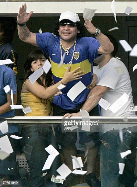 Argentina's former soccer star Diego Maradona and his daughter Giannina are seen at La Bombonera stadium during the Apertura tournament match between...