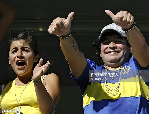 Argentine former soccer star Diego Maradona and his daughter Giannina cheer for Boca Juniors before the start of their Argentina's first division...