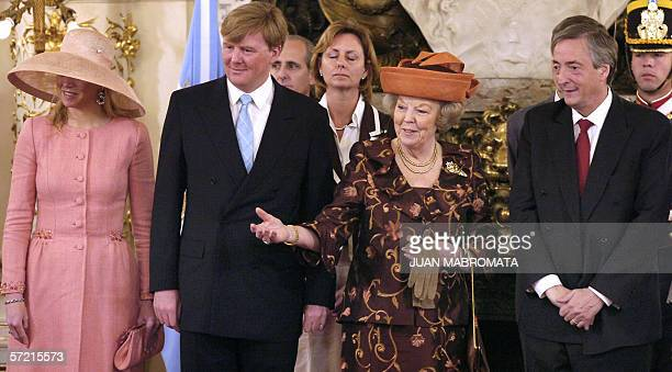 Argentine President Nestor Kirchner receives 30 March 2006 at Casa Rosada presidential house in Buenos Aires Holland's Queen Beatrix accompanied by...