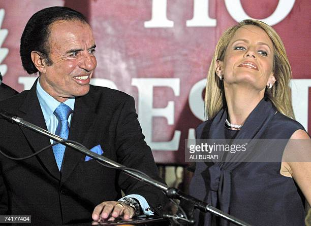 Argentine presidential candidate Carlos Menem of the Peronist Party looks at his wife Cecilia Bolocco 27 April 2003 at a balcony on a Buenos Aires...