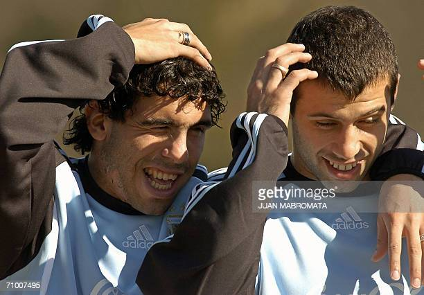 Argentinians Carlos Tevez and Javier Mascherano player of the Brazilian Corinthians share a joke during a training session of Argentina's National...