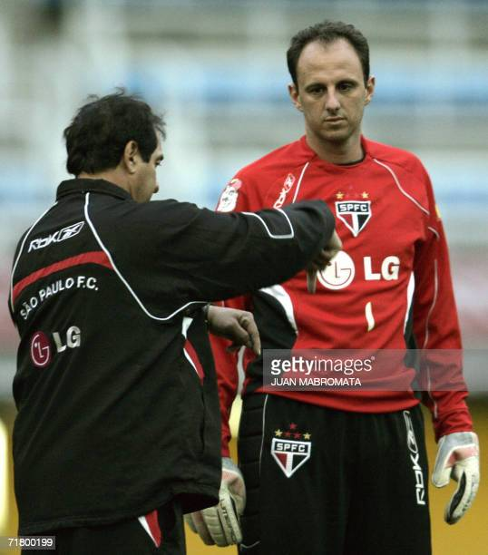 Brazil's Sao Paulo FC football team head coach Muricy Ramalho gives instructions to goalkeeper Rogerio Ceni during their training session at La...
