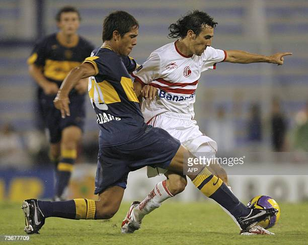 Forward Vicente Sanchez of Mexico's CD Toluca vies for the ball with defender Jonatan Maidana of Argentina's Boca Juniors during their Libertadoras...