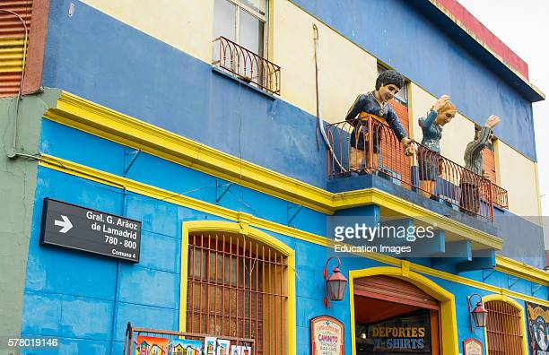 Buenos Aires Argentina La Boca colorful street with murals on roof of building