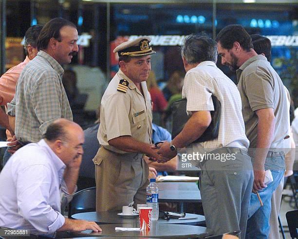 Los asambleistas de Gualeguaychu Jose Pouler Juan Ferrari y Jorge Fritzler se saludan con un oficial de Prefectura Naval en el bar de la empresa...