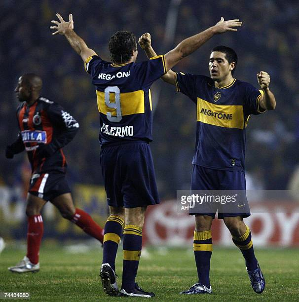 Martin Palermo and Roman Riquelme of Boca Juniors celebrates at the end of the of the semifinal football match of the Copa Libertadores 2007 at La...