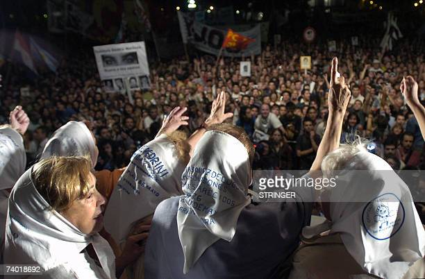 Members of Madres de Plaza de Mayo human rights organization wave at demonstrators from a stage set at the Plaza de Mayo in Buenos Aires 24 March...